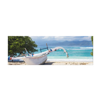 Jukung outrigger boat on a white sand beach canvas print