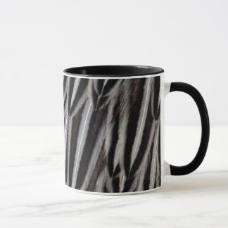 Jungle cock feathers close-up mug