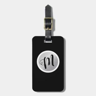 just a simple circle monogram on black luggage tag