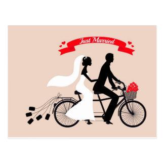 Just married, bride and groom on wedding bicycle postcard