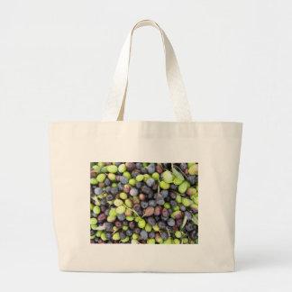 Just picked olives background during harvest time large tote bag