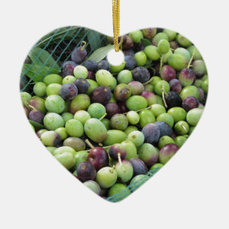 Just picked olives on the net during harvest time ceramic heart ornament