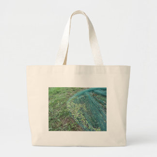 Just picked olives on the net during harvest time large tote bag