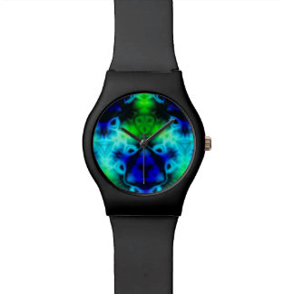 Kaleidoscope image with blues and gree watch
