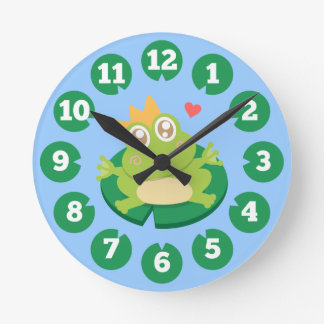 Kawaii frog with sparkling eyes on a lily pad round clock