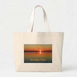 Kayaking at sunset large tote bag