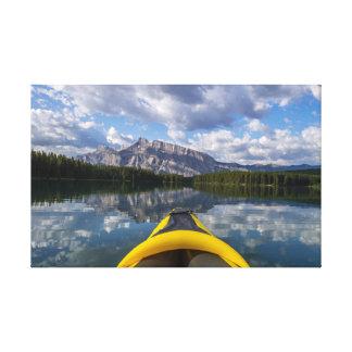 Kayaking on sunrise at Two Jack lake Canvas Print