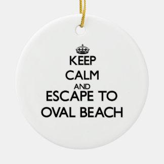 Keep calm and escape to Oval Beach Michigan Round Ceramic Ornament