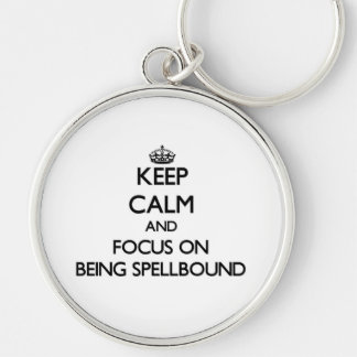 Keep Calm and focus on Being Spellbound Key Chains