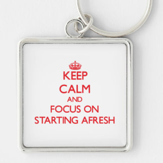 Keep calm and focus on STARTING AFRESH Keychains