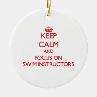 Keep Calm and focus on Swim Instructors Round Ceramic Ornament