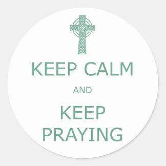 Keep Calm and Keep Praying Classic Round Sticker