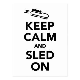 Keep calm and sled on postcard