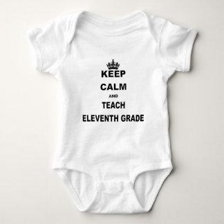 KEEP CALM AND TEACH ELEVENTH BABY BODYSUIT