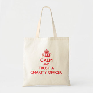 Keep Calm and Trust a Charity Officer Tote Bags