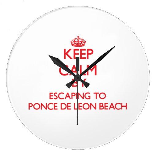 Keep calm by escaping to Ponce De Leon Beach Flori Wall Clocks
