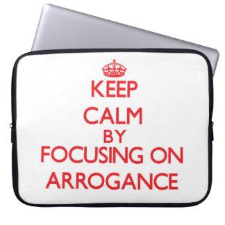 Keep Calm by focusing on Arrogance Computer Sleeves