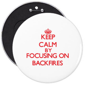 Keep Calm by focusing on Backfires Pinback Buttons