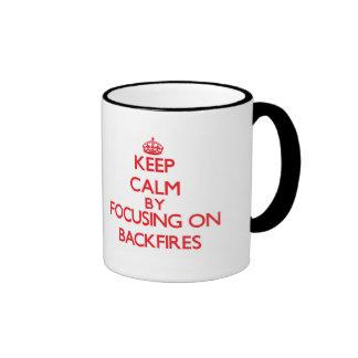Keep Calm by focusing on Backfires Ringer Coffee Mug
