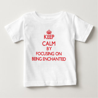 Keep Calm by focusing on BEING ENCHANTED Tshirts