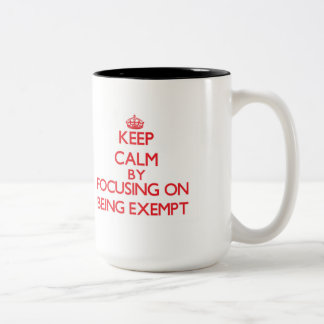 Keep Calm by focusing on BEING EXEMPT Coffee Mug