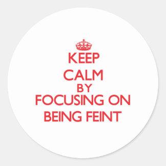Keep Calm by focusing on Being Feint Round Sticker