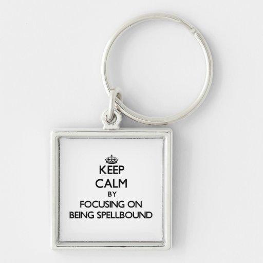 Keep Calm by focusing on Being Spellbound Keychain