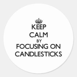 Keep Calm by focusing on Candlesticks Round Sticker