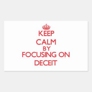 Keep Calm by focusing on Deceit Rectangular Sticker