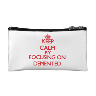 Keep Calm by focusing on Demented Makeup Bags