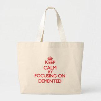 Keep Calm by focusing on Demented Tote Bag
