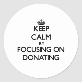 Keep Calm by focusing on Donating Sticker
