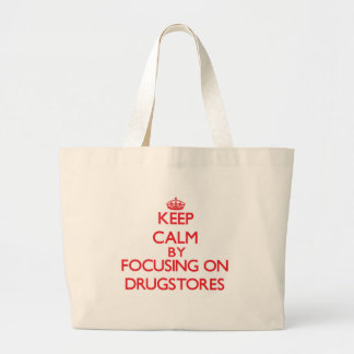 Keep Calm by focusing on Drugstores Canvas Bags
