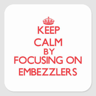 Keep Calm by focusing on EMBEZZLERS Stickers