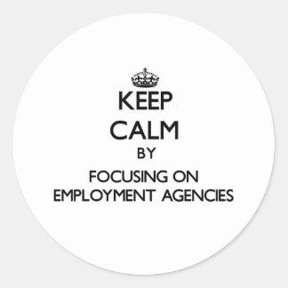 Keep Calm by focusing on EMPLOYMENT AGENCIES Round Sticker