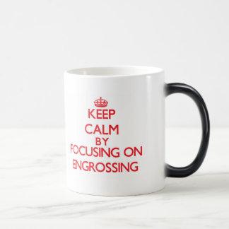 Keep Calm by focusing on ENGROSSING Coffee Mugs
