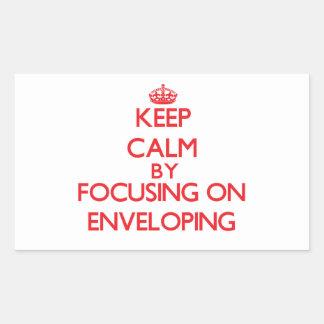Keep Calm by focusing on ENVELOPING Rectangular Sticker