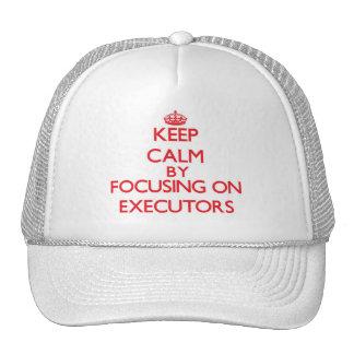 Keep Calm by focusing on EXECUTORS Trucker Hat