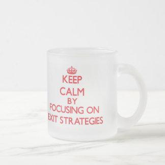Keep Calm by focusing on EXIT STRATEGIES Mugs