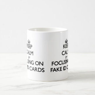 Keep Calm by focusing on Fake Id Cards Basic White Mug