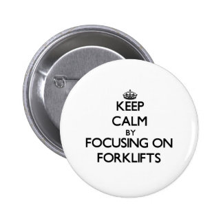 Keep Calm by focusing on Forklifts Pinback Buttons