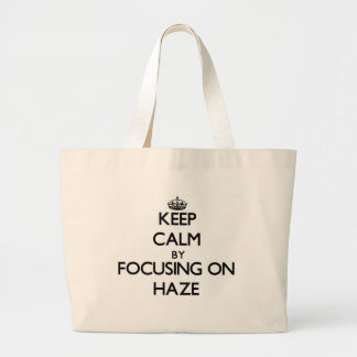 Keep Calm by focusing on Haze Tote Bags