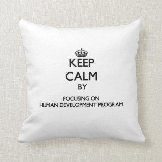 Keep calm by focusing on Human Development Program Throw Pillows