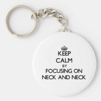 Keep Calm by focusing on Neck And Neck Key Chains