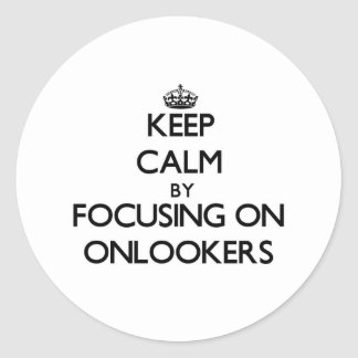 Keep Calm by focusing on Onlookers Round Stickers