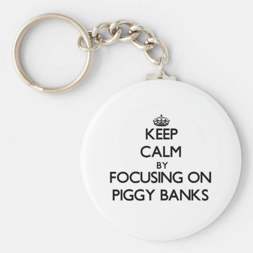 Keep Calm by focusing on Piggy Banks Key Chain