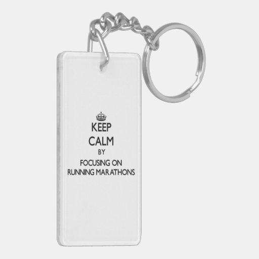 Keep Calm by focusing on Running Marathons Rectangle Acrylic Key Chains