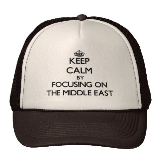 Keep Calm by focusing on The Middle East Trucker Hats