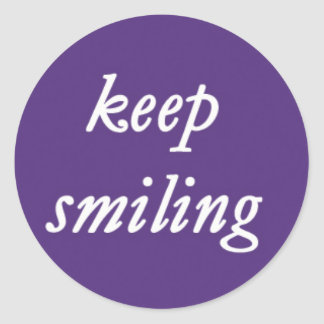 Keep Smiling on a Purple Background Round Sticker