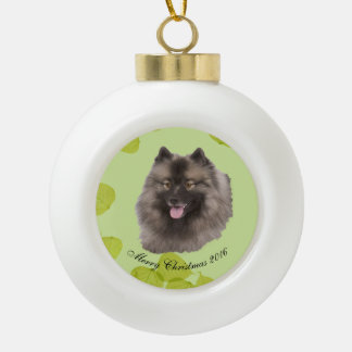 Keeshond on Green Leaves Ceramic Ball Christmas Ornament